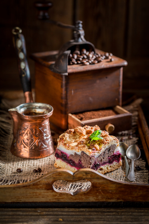Closeup of tasty cherry pie with pot boiled coffee