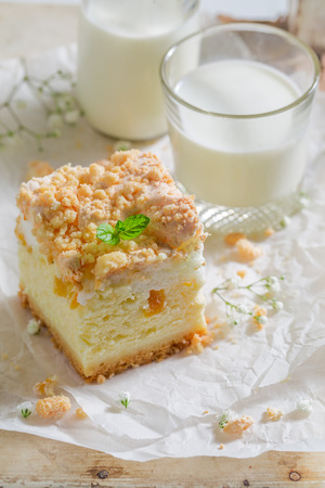 Closeup of cheesecake made of peach and crumble