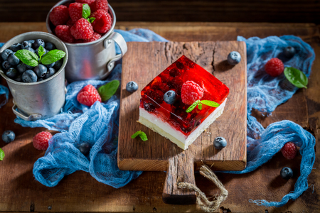 Top view of tasty cake with fresh berries and jelly
