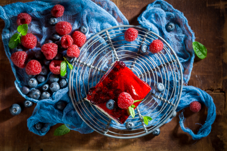 Top view of homemade cake with fresh berries and jelly