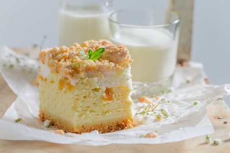 Sweet cheesecake with sweet peach and crumble Stock Photo