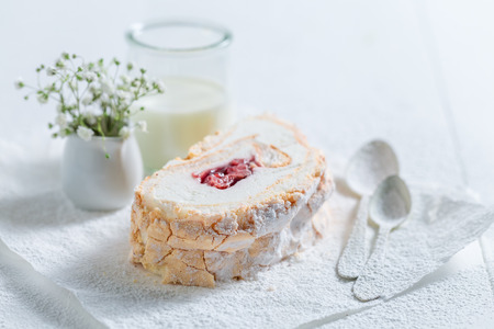 Closeup of meringue cake with fresh strawberry on white paper Stok Fotoğraf