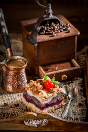 Sweet and tasty cherry pie with pot boiled coffee