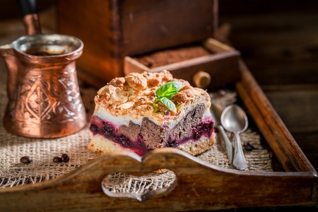 Sweet cherry pie with pot boiled coffee on wooden tray Stock Photo