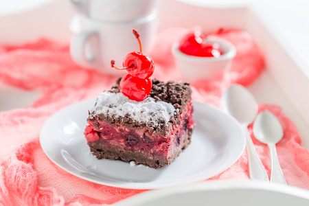 Closeup of chocolate cake with cherries and crumble Stock Photo