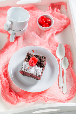 Top view of chocolate cake with crumble and cherries Stock Photo