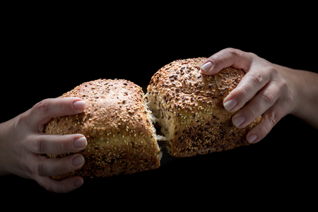 Homemade bread in the woman hands on black background Archivio Fotografico - 113099731