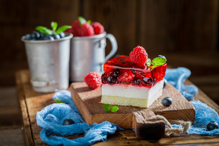 Closeup of sweet cake with jelly and berry fruits
