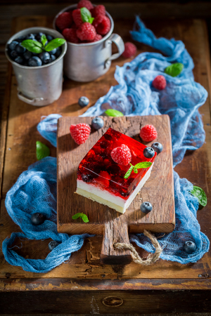 Closeup of delicious cake with jelly and berry fruits
