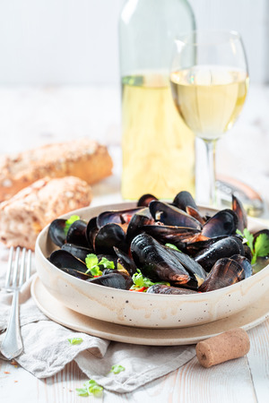 Homemade mussels served with cold white wine