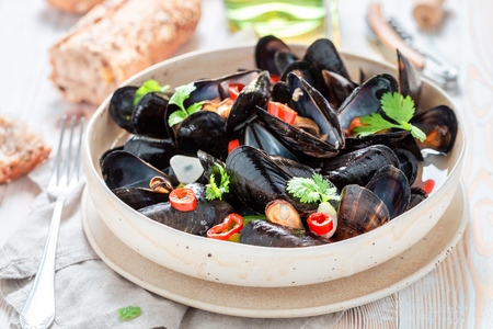 Homemade mussels served with tasty wholemeal bread