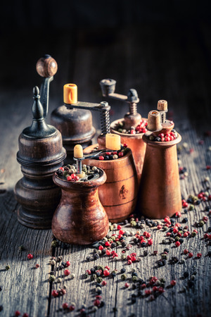Spicy pepper mills with different types of pepper Stock Photo