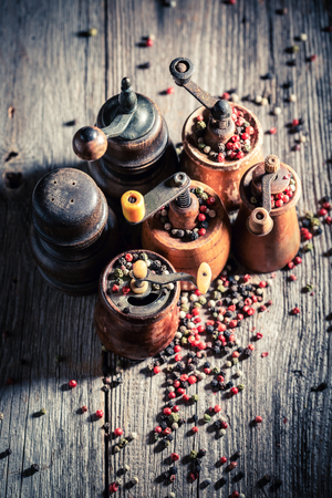 Wooden pepper mills with black and red pepper