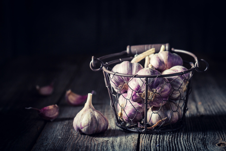 Aromatic rustic garlic in old wooden box