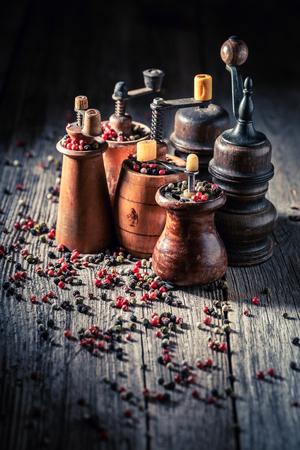 Old pepper mills with black and red pepper Reklamní fotografie