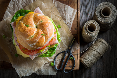 Top view of take away sandwich packed in gray paper