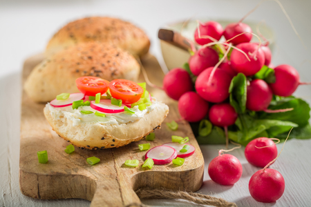 Closeup of sandwich with bread, radish and fromage cheese