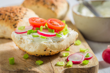Closeup of sandwich with fresh radish, creamy cheese and tomatoes Stok Fotoğraf