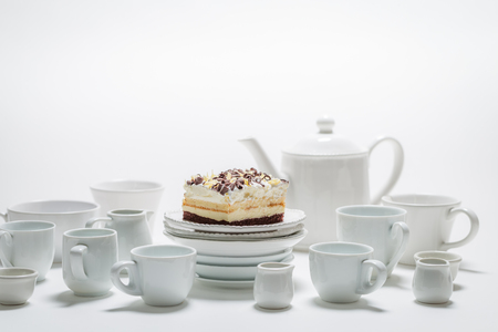 White cake with mousse, chocolate and white porcelain