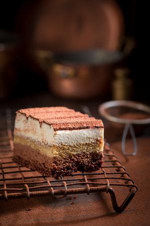 Sweet tiramisu cake with cocoa powder, mascarpone and biscuits Stock Photo