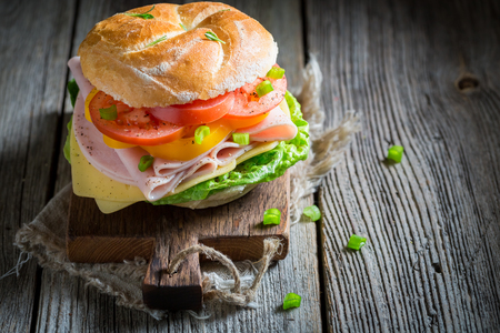 Closeup of crisp sandwich with vegetables and ham