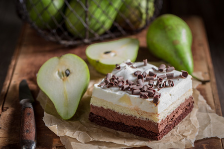 Closeup of sweet pear cake with fresh fruits