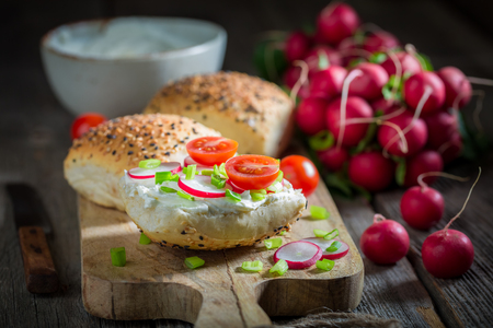 Sandwich with radish, creamy cheese and tomatoes Stok Fotoğraf