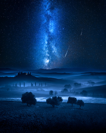 Milky way and falling stars over valley in Italy