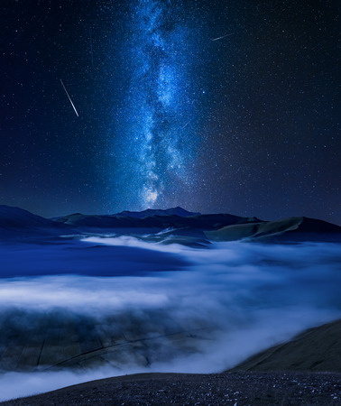 Milky way over foggy valley in Umbria, Italy