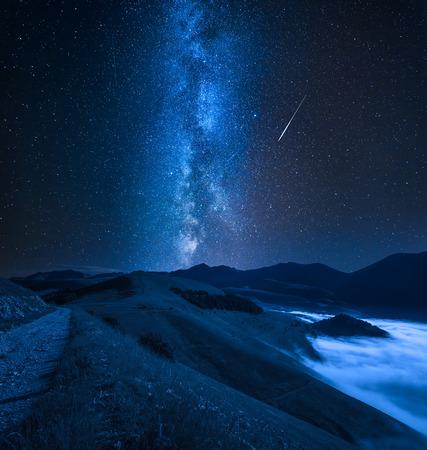 Milky way over foggy valley in the Castelluccio, Umbria, Italy Reklamní fotografie