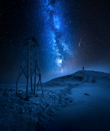 Milky way over a man in Tatras in winter Stock Photo