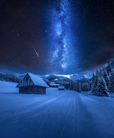 Milky way over snowy road in Tatra Mountains, Poland