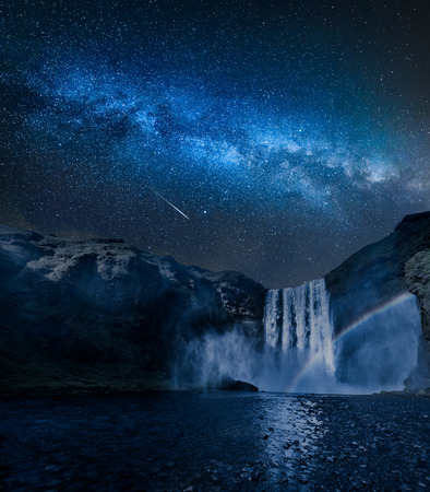 Stunning milky way and waterfall Skogafoss in Iceland at night Reklamní fotografie