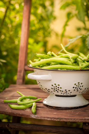 Closeup of green beans in a colander Stock Photo