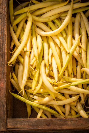 Closeup of yellow beans in a old wooden box Stock Photo