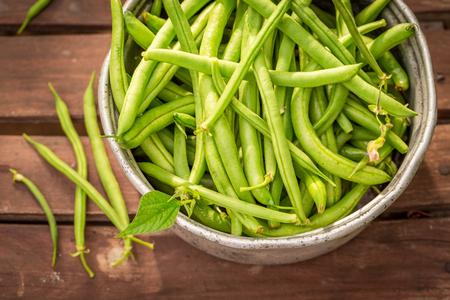 Raw green beans in an old aluminum pot
