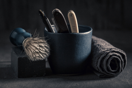 Vintage barber equipment with soap, brush and old razor