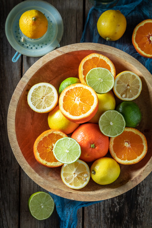 Tasty mix of citrus fruits with on wooden table