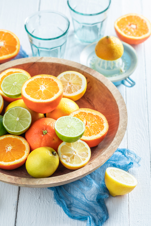 Sweet oranges, limes and lemons with on rustic table Stockfoto