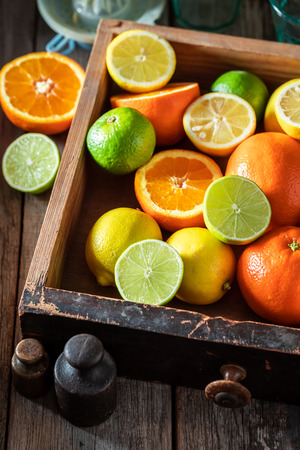 Sweet mix of citrus fruits with on rustic table Stockfoto