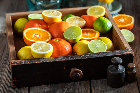 Fresh mix of citrus fruits with on rustic table