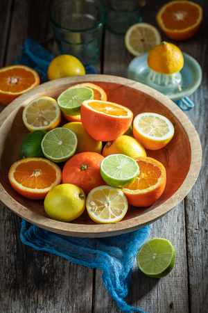 Healthy mix of citrus fruits with on rustic table