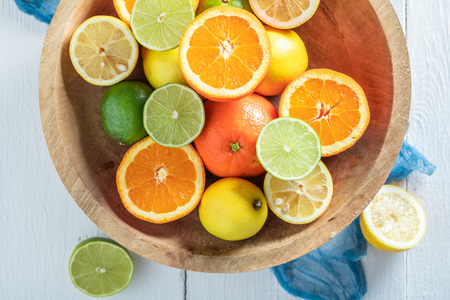 Fresh oranges, limes and lemons with on wooden table Stockfoto