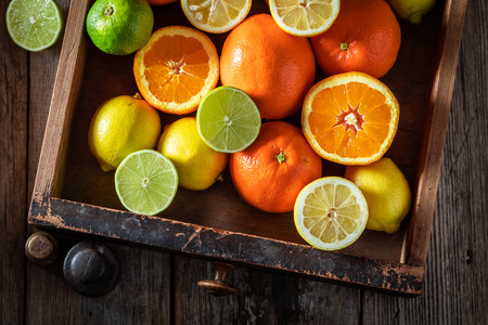 Sweet mix of citrus fruits with on wooden table