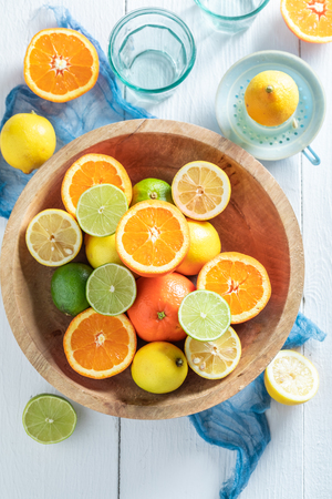 Healthy oranges, limes and lemons with on wooden table