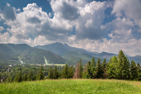 Mount Giewont and ski jump in cloudy in summer, Poland