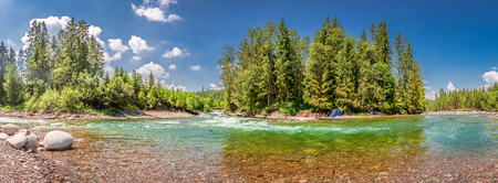 Panorama of wild river and tent inTatras mountains, Slovakia