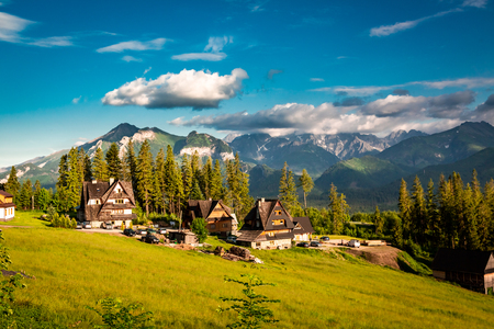 Wonderful Tatra mountains and few houses at sunset in summer