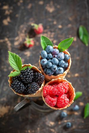 Fresh berry fruits in waffels as ice cream concept