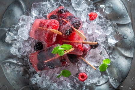 Delicious berry fruits ice cream on cold ice